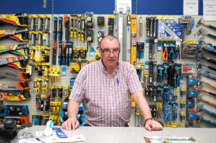 Behind the counter at Tadgh O'Connor's Hardware store